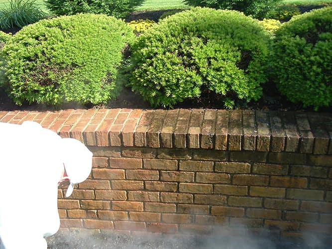 pressure washing retaining wall
