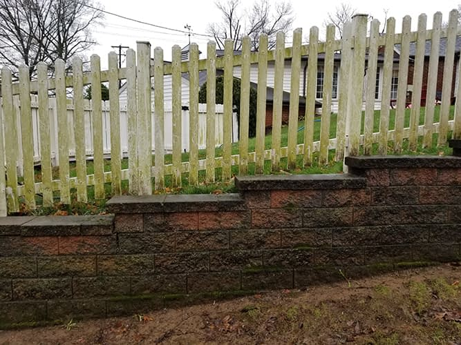 vinyl fence washing and retaining wall